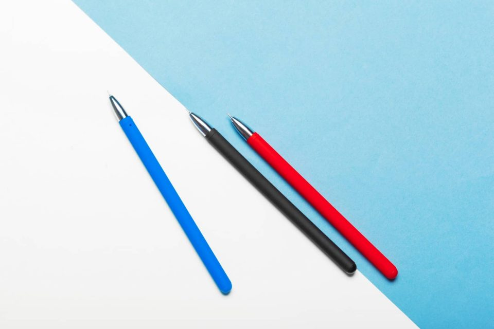Top view workspace mockup on blue background with notebook, pen